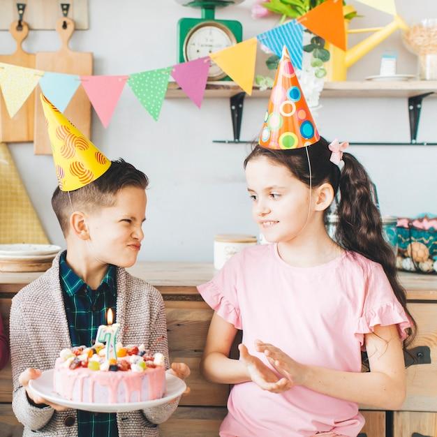 Children celebrating a birthday Free Photo