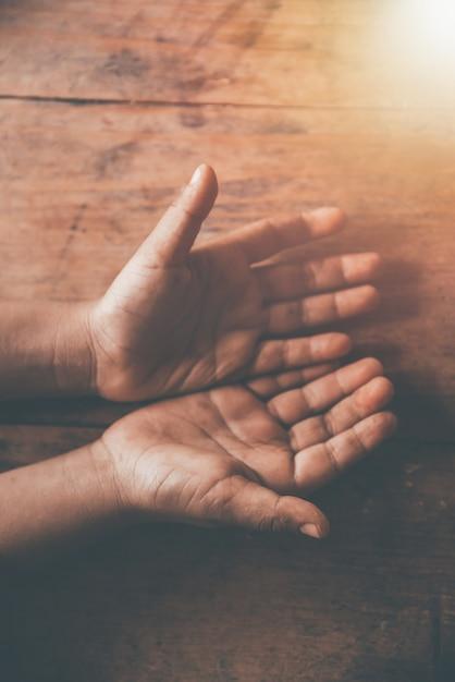 Children dirty open hand begging for money Premium Photo