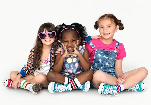 Children girlfriends smiling happiness friendship togetherness studio portrait Premium Photo