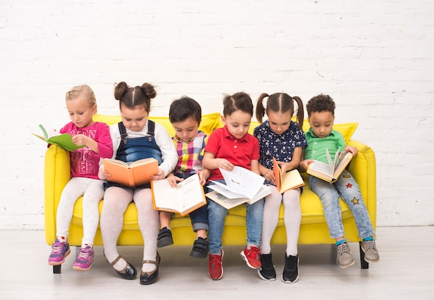 Children group reading books Free Photo