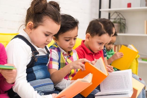 Children group reading books Free Photo