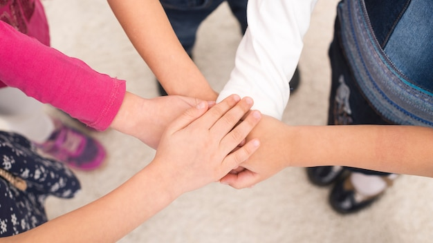 Children holding hand in group Free Photo