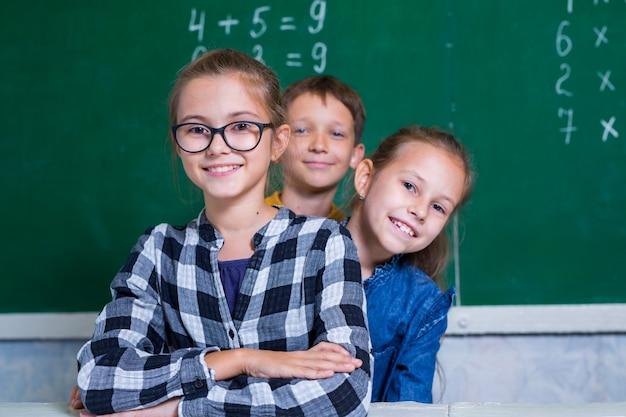 Children do math in elementary school. Premium Photo