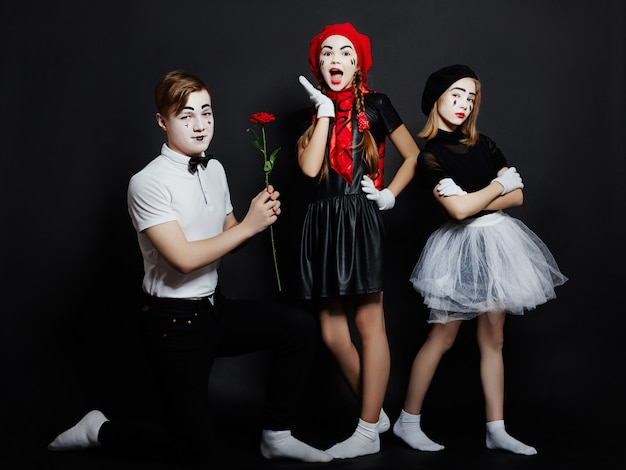 Children mime group photo, pantomime emotions Premium Photo