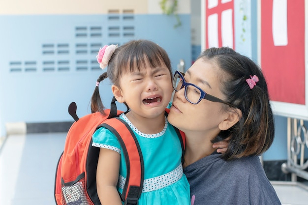 Children and mother crying first day go to pre-kindergarten school Premium Photo