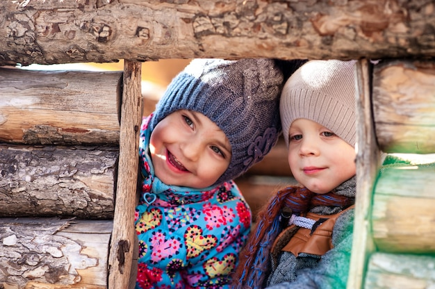 Children play in a wooden house Premium Photo