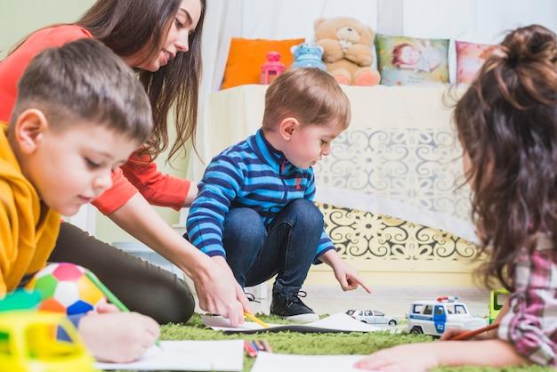 Children playing on floor Free Photo