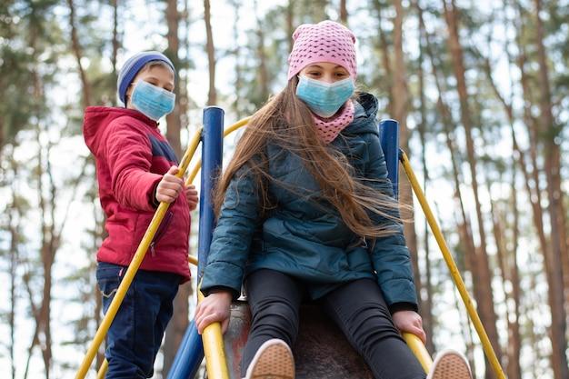 Children playing on playground during coronavirus epidemic Premium Photo