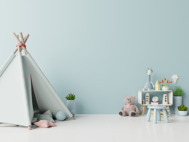 Children playroom with tent and table sitting doll on empty blue wall background. Premium Photo