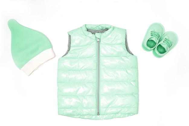 Children's clothes in fashionable color. hat, shoes, quilted jacket Premium Photo