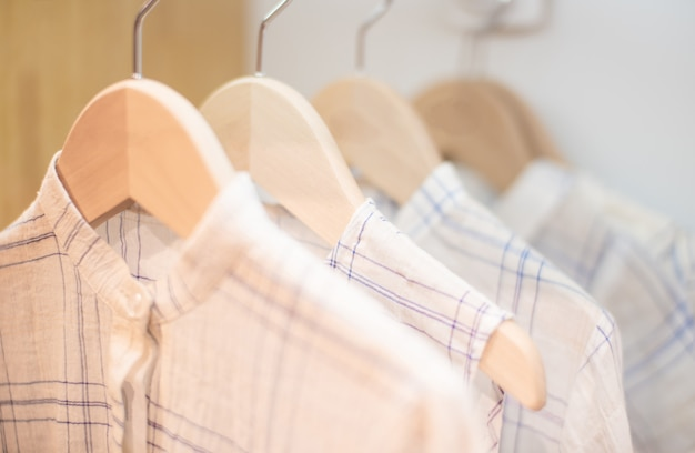Children's clothes on laundry line against white background Premium Photo