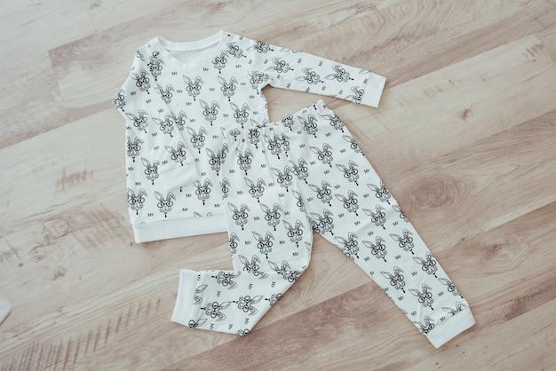 Children's clothing set isolated on wooden background Premium Photo