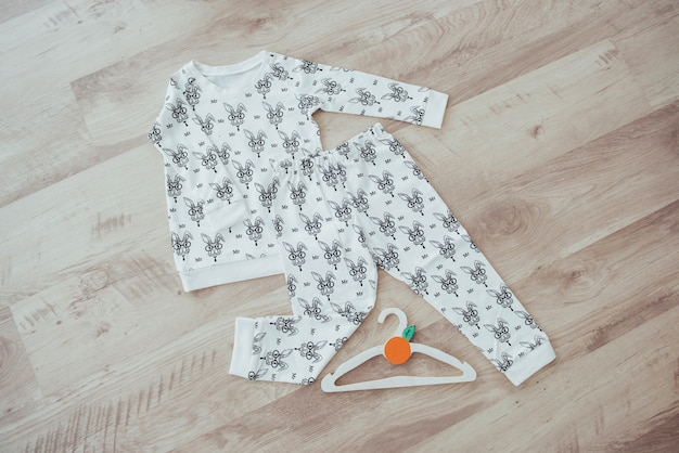 Children's clothing set isolated on wooden background Premium Photo
