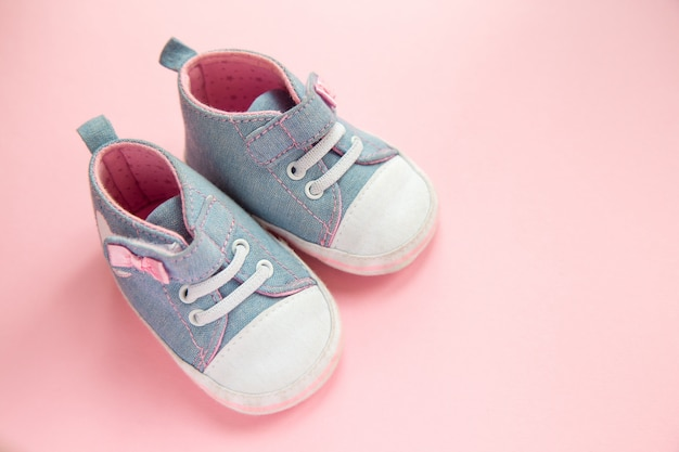 Children's denim sports shoes for girls, stands on a pink Premium Photo