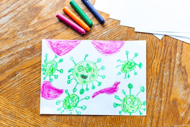 Premium Photo Children S Drawing Coronavirus Many Viruses Attack The Human Body Crayons Colored Pencils Children S Creativity Creating Crafts Home Decoration Time With Children Skill Development School Home