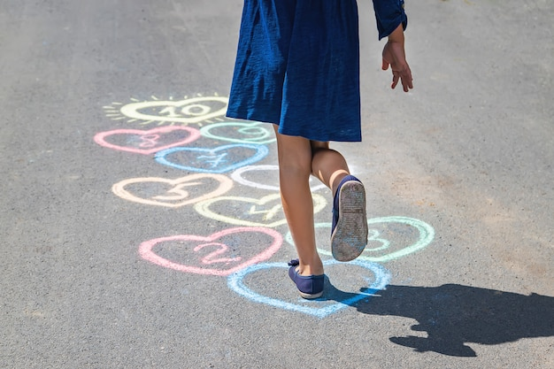 Children's hopscotch game on the pavement Premium Photo