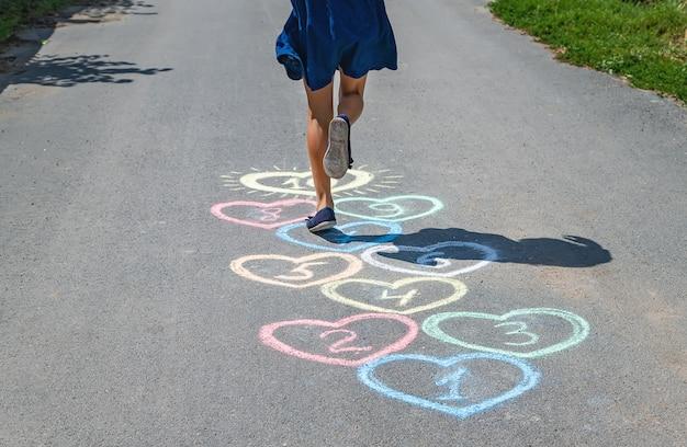 Children's hopscotch game on the pavement Premium Photo