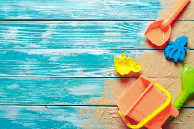 Children toys on wooden deck background with copyspace Premium Photo