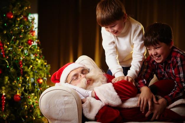 Children waking up to santa claus Free Photo