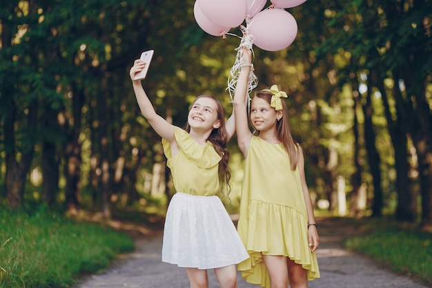 Children with ballons Free Photo