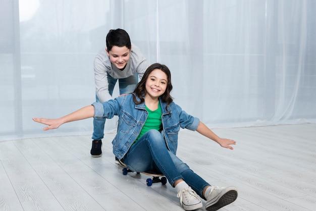 Childrens riding skateboard Free Photo