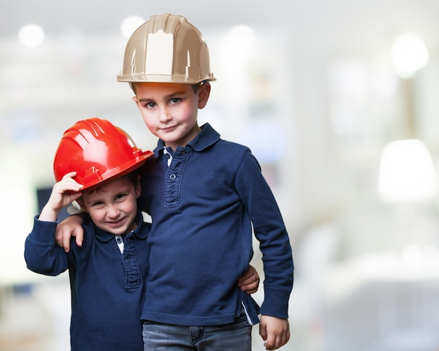 Childs with work helmets Free Photo