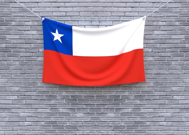 Chile flag hanging on brick wall Premium Photo