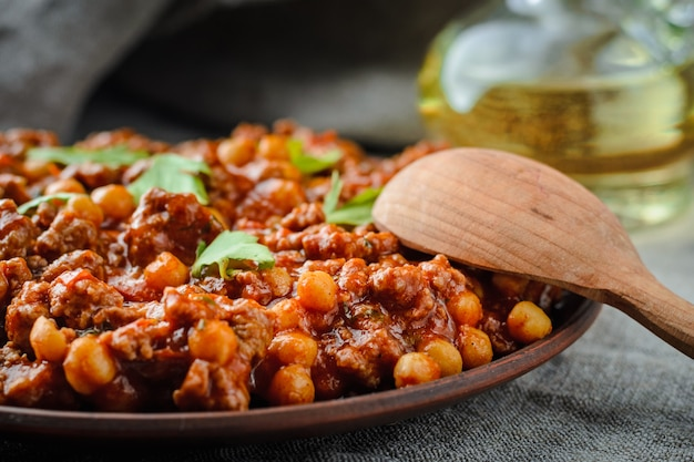 Chile with pork and chickpeas in a dark key Premium Photo
