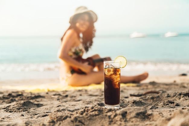 Chilling drink on beach Free Photo