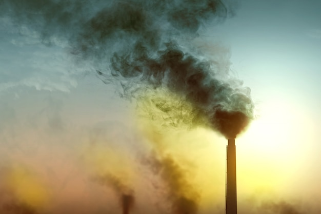 Chimney results in air pollution from the industrial activity Premium Photo