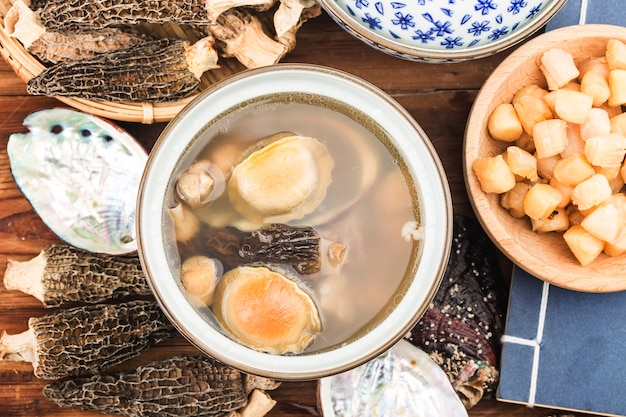 Chinese cuisine-abalone and morel soup Premium Photo