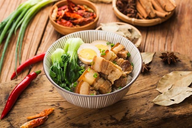 Chinese cuisine - braised pork rice Premium Photo
