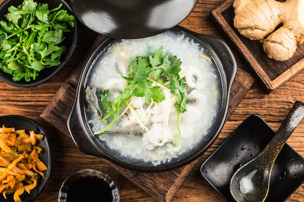 Chinese cuisine congee with fish slices in casserole Free Photo