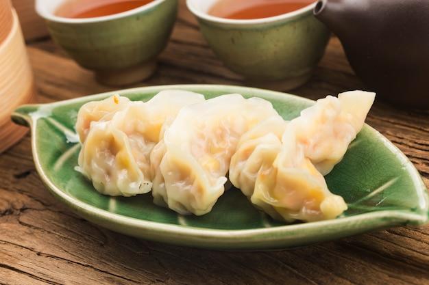 Cucina cinese: un piatto di gnocchi al vapore snack Foto Gratuite