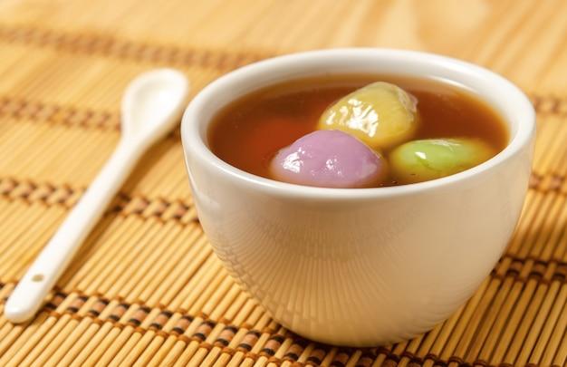 Premium Photo   Chinese dessert glutinous rice balls with black sesame past  (tang yuan)