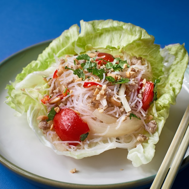 Chinese dishes for the new year. rice noodles with vegetables salad in a dish Premium Photo