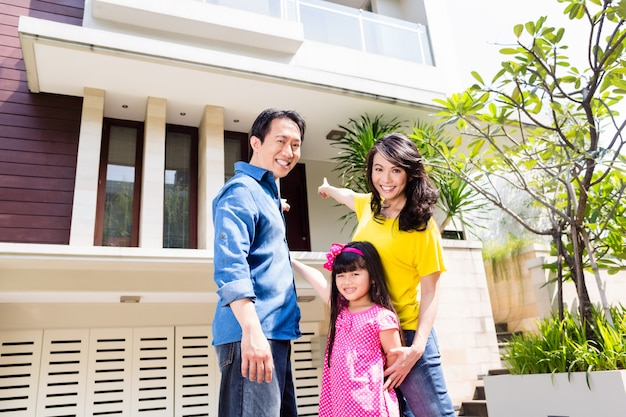Chinese family in front of house Premium Photo