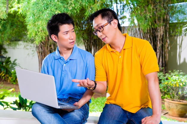 Chinese father and asian son at home Premium Photo
