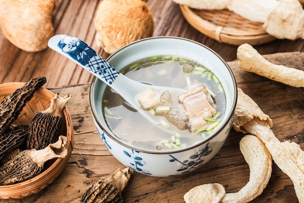 Chinese food in chine soup with scallop and bamboo fungus Premium Photo