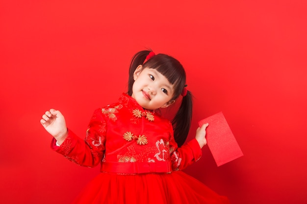 A chinese girl celebrates chinese new year with a red envelope Premium Photo