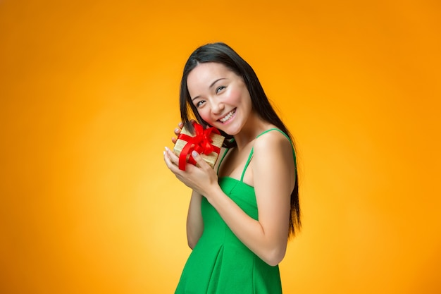 Chinese girl with a gift Free Photo
