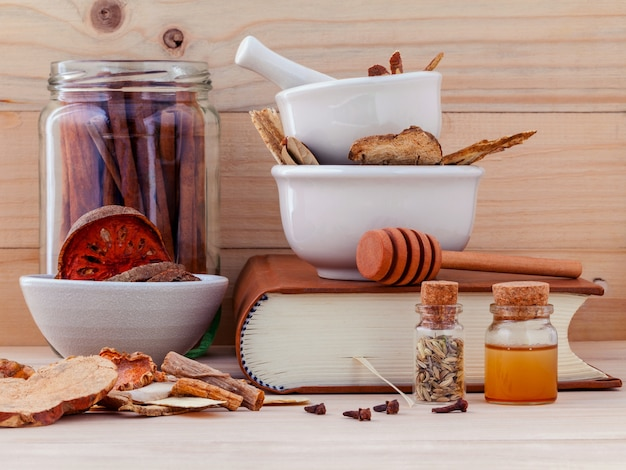 Chinese herbal medicine  for healthy recipe on wooden background. Premium Photo