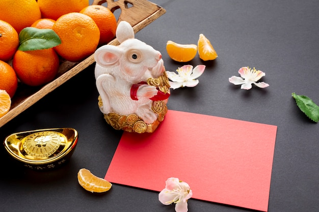Chinese new year card mock-up with rat figurine Free Photo