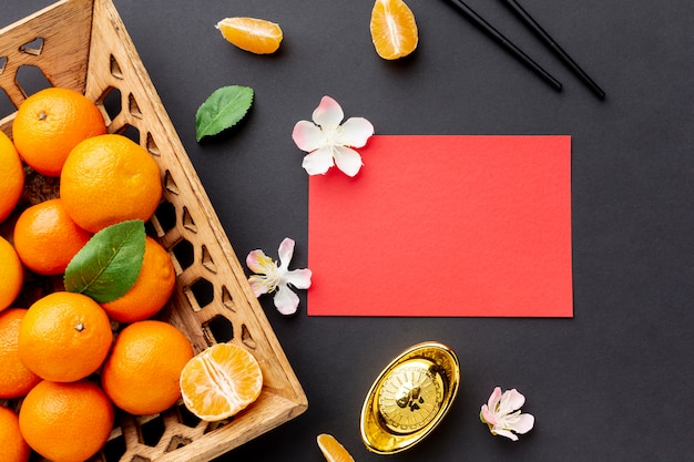 Chinese new year card mock-up with tangerines Free Photo