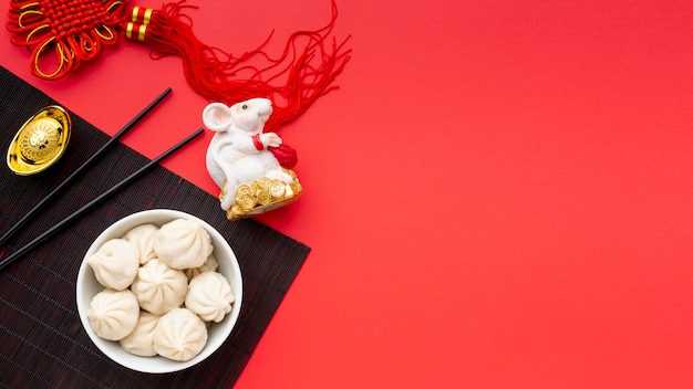 Chinese new year dumplings with rat figurine Free Photo