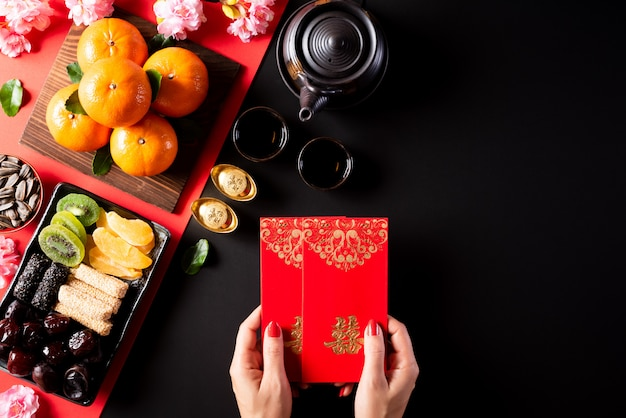 Chinese new year festival decorations on a black background. Premium Photo