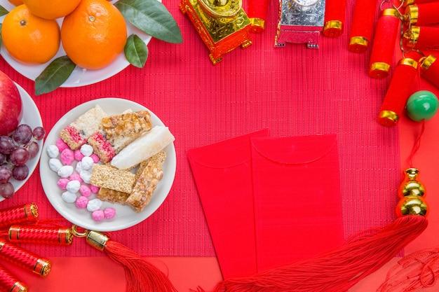 食物と一緒に中国の新年祭の装飾 Premium写真