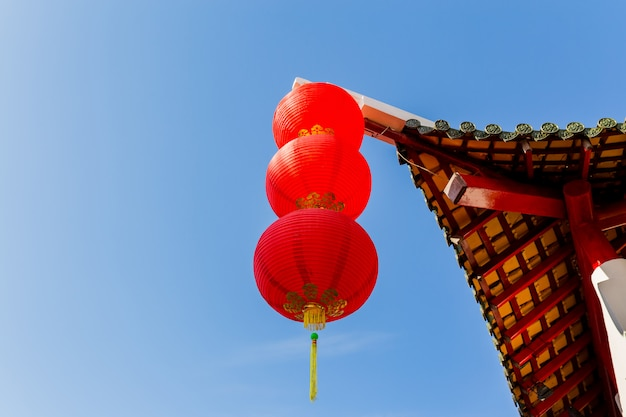Chinese pavilion arch with blue sky, happy chinese new year Premium Photo