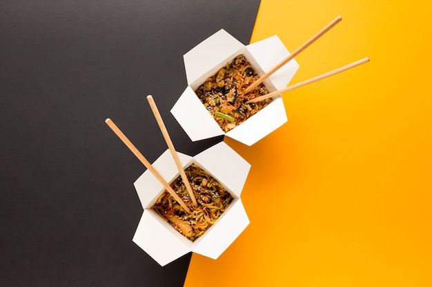 Chinese takeout with chopsticks Free Photo