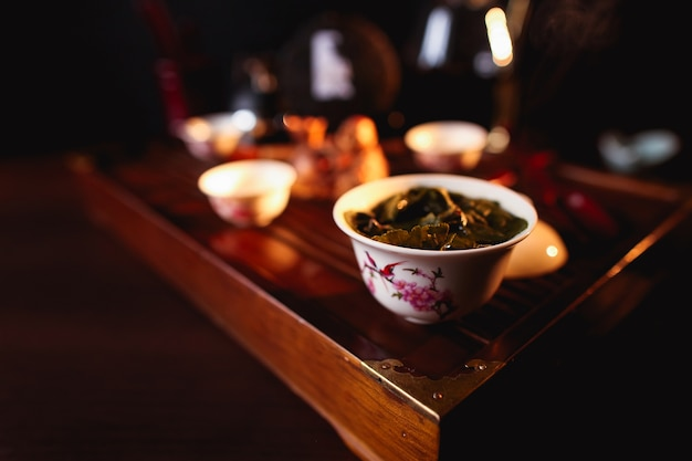 Chinese tea ceremony. cup of tea on tea desk chaban. Free Photo